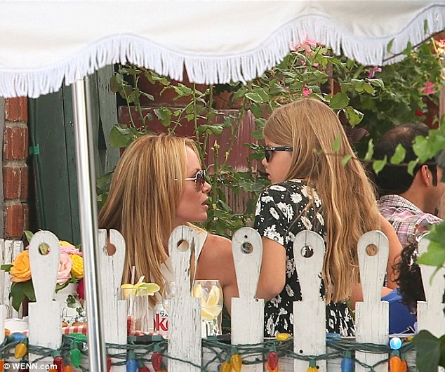 It's good to talk: The ladies chat as they spend time on the popular eatery's patio