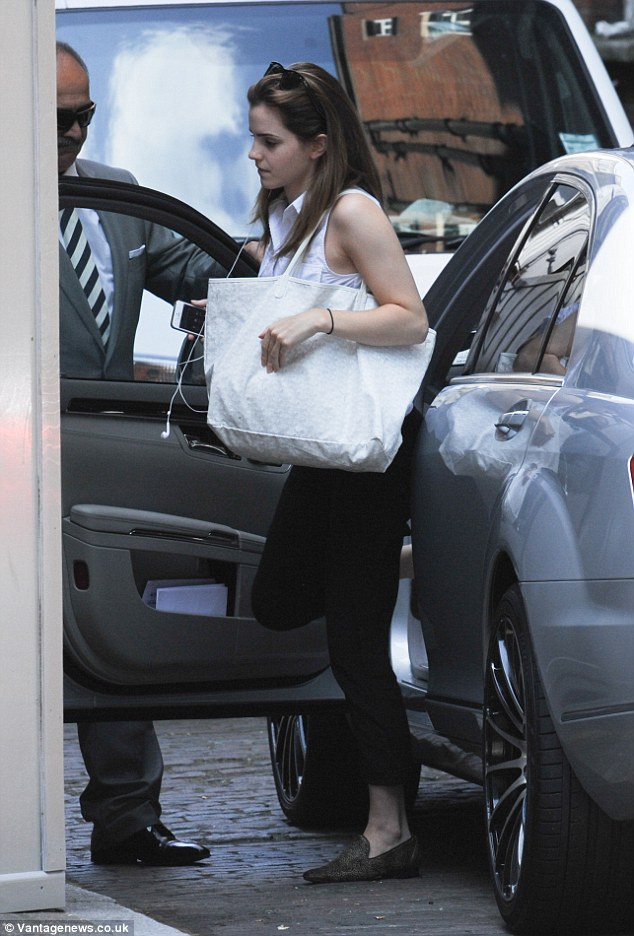 Stepping out: The actress pulls out her earphones as she arrives at the coffee shop and gets out of the front seat of her ride
