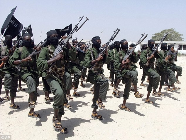 Members of the militant group al-Shabab who have allegedly shot dead a woman for not wearing a veil