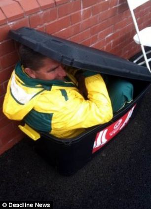 Kelvin Kerkow hiding in the bin during the lawn bowls match