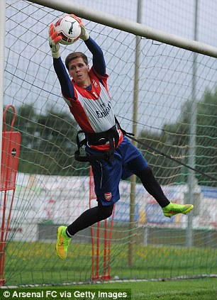 Safe hands: Szczesny plucks the ball out of the air
