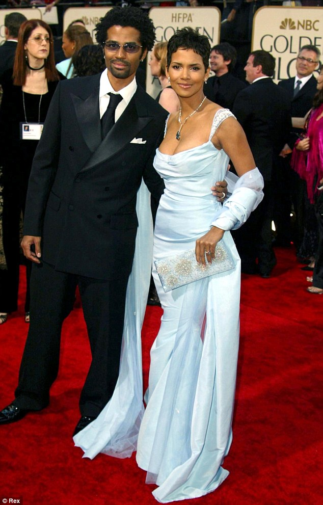 Back in their married days: Eric with Halle - both 47-years-old now - in January 2003