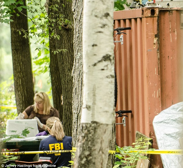 What did they find? Police seen Wednesday cataloging evidence from inside a shipping container on Nathaniel Kibby's property in Gorham, New Hampshire. He was arraigned Tuesday on charges of kidnapping Abigail Hernandez in October