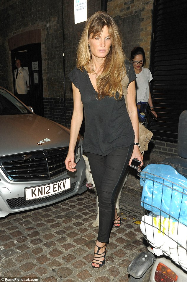 All-black ensemble: The London socialite sported black tailored jeans with a matching blouse, which she teamed with strappy high heeled shoes