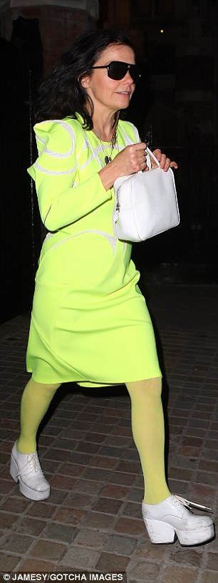 Bold impact: The 48-year-old teamed her look with white platform shoes and a matching handbag