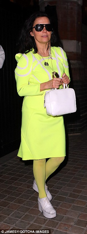 Making a statement: Singer Bjork stands out in neon green as she leaves the Chiltern Firehouse on Wednesday evening