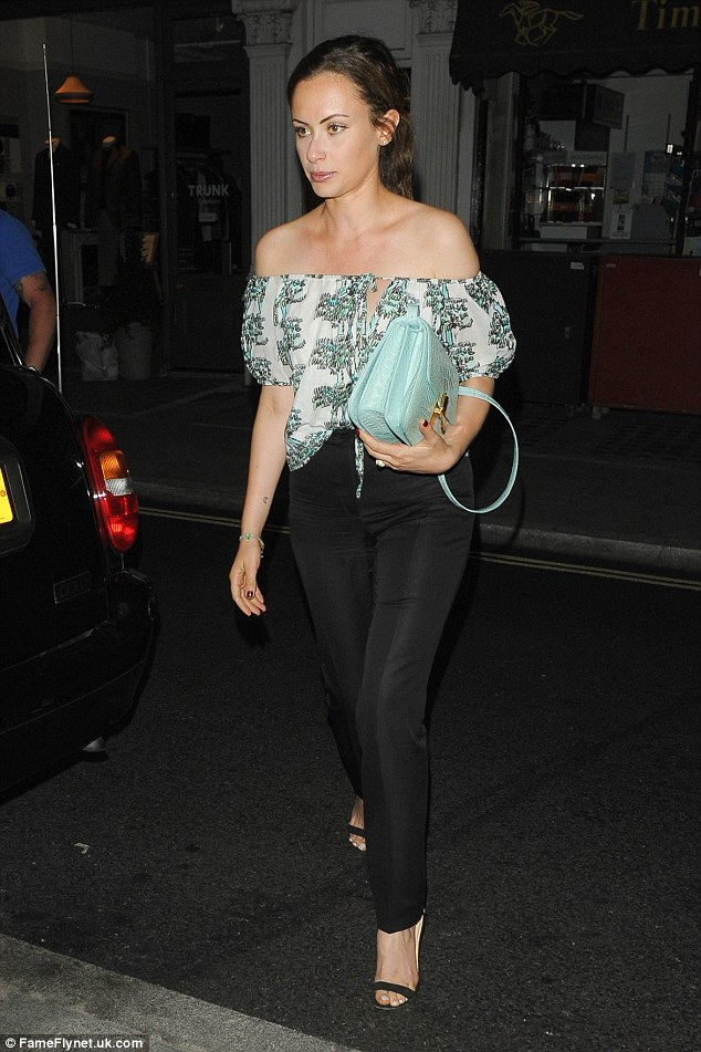 Stylish exit:Camilla Al Fayed looked beautiful in black trousers and a white and blue printed blouse