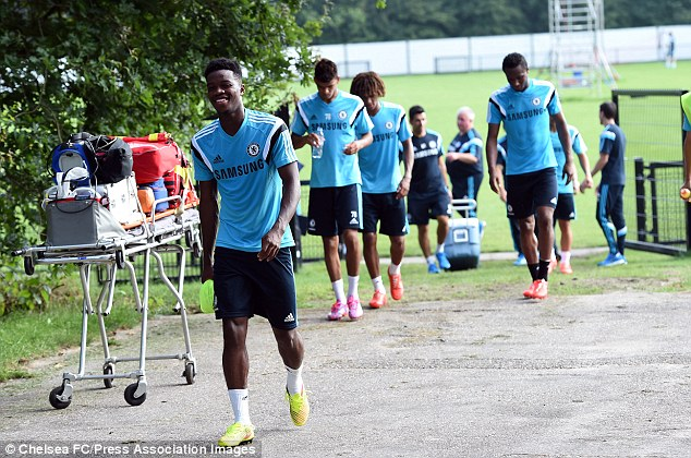 Having a laugh: Nathaniel Chalobah leaves one of the last session's for Chelsea's youngest players