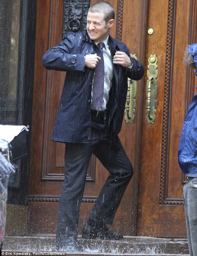 Gordon Bennett: Benjamin McKenzie did not seemed to enjoy gettng soaked on the set of Gotham in New York on Wednesday