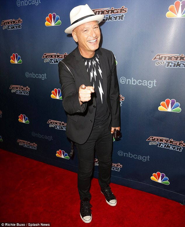Cool cat: Howie Mandel sported a black blouse with white lightning strikes, a black blazer, skinny trousers, Converse sneakers and a matching