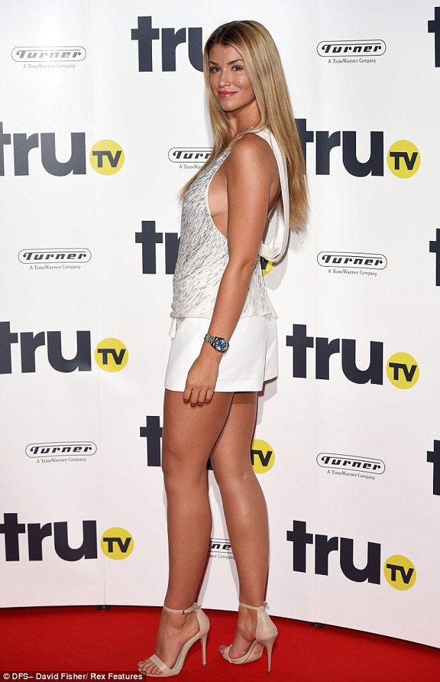 White on trend: Amy teamed the wide-cut top with loose white shorts and a pair of nude strappy heels