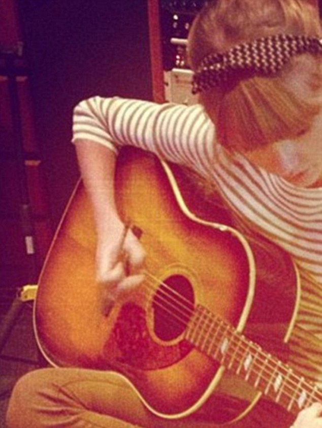 Plucky agony aunt: Only a week ago Taylor, seen with the guitar her fan recently won, gave some wise words to another lovelorn teen via Instagram