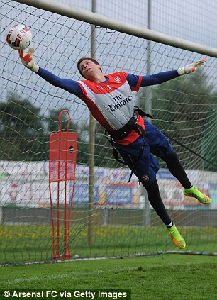 Tied up: Wojciech Szczesny tries out the new training equipment