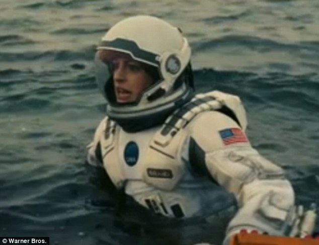 Hope the suit is buoyant: Anne is shown wading through water as they explore their new surroundings