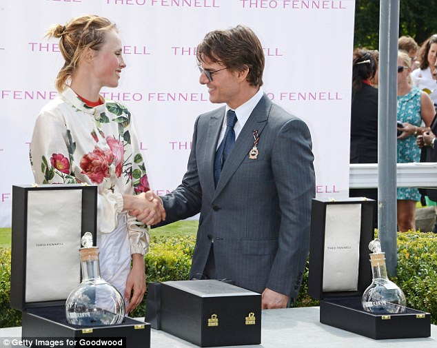 Plaudits: The star smiles as he presents the Magnolia Cup supermodel winner Edie Campbell
