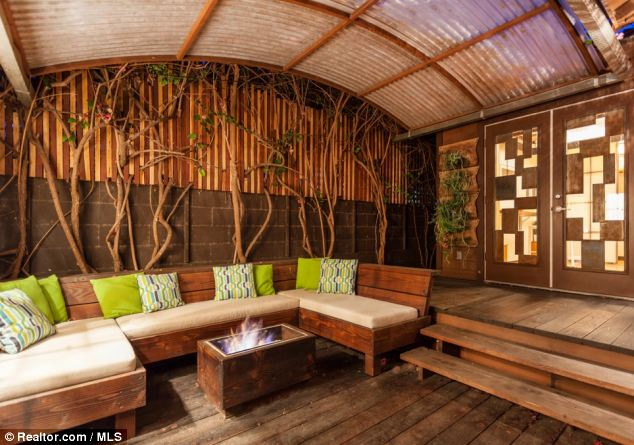 Outside: Through doorways in the bedroom, there is a private deck which has a fire pit beneath a table