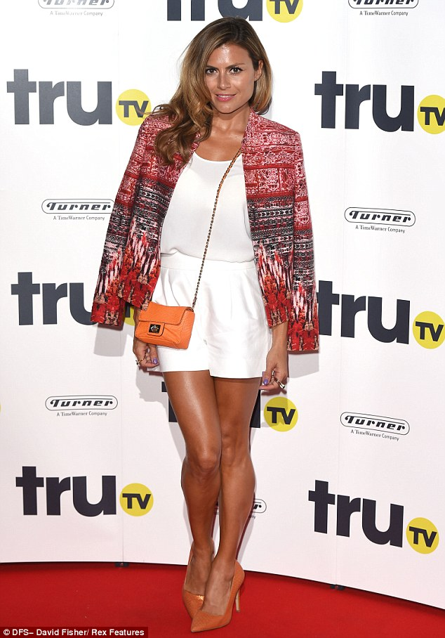 Standout: TV presenter Zoe Hardman looked chic in a white playsuit while she slung her mulit-patterned jacket over her shoulders