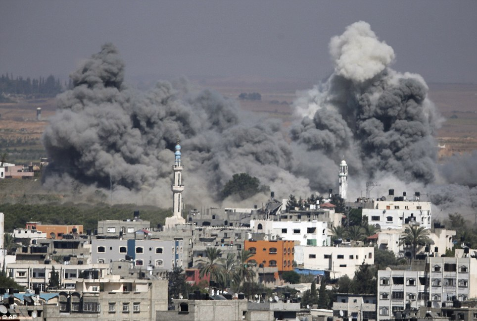 Blast: Smoke rises after an Israeli strike in Gaza City yesterday. Israel and Hamas have agreed to a 72-hour humanitarian ceasefire beginning today