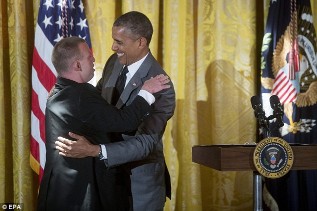 Barack Obama embraces restaurateur Tim Harris after the President mentioned him while speaking at an event honoring the Special Olympics at the White House on Thursday