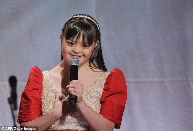 Special Olympian Brina Kei Maxino of the Philippines, who has Down Syndrome, speaks to the distinguished audience at the White House on Thursday