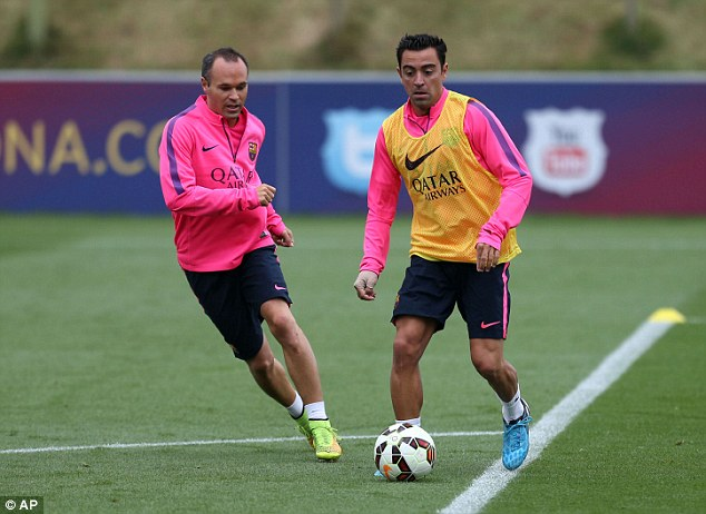 La Liga legends: Xavi and Andres Iniesta in action during a training session in Burton-upon-Trent