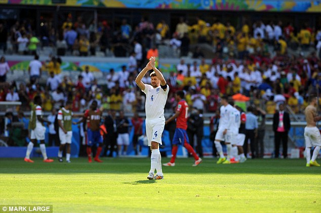 Thanks for coming: Three Lions' captain Steven Gerrard acknowledges the travelling England supporters