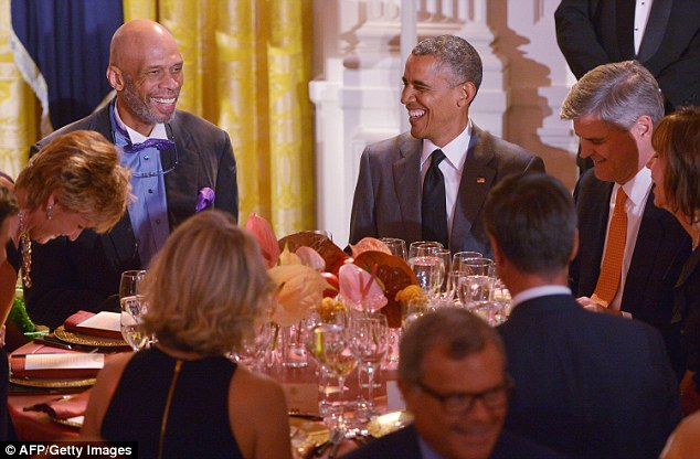 Obama, with basketball legend Kareem Abdul-Jabbar to his left, enjoys dinner at the event to honor the Special Olympics which were established in 1968 by Eunice Kennedy Shriver