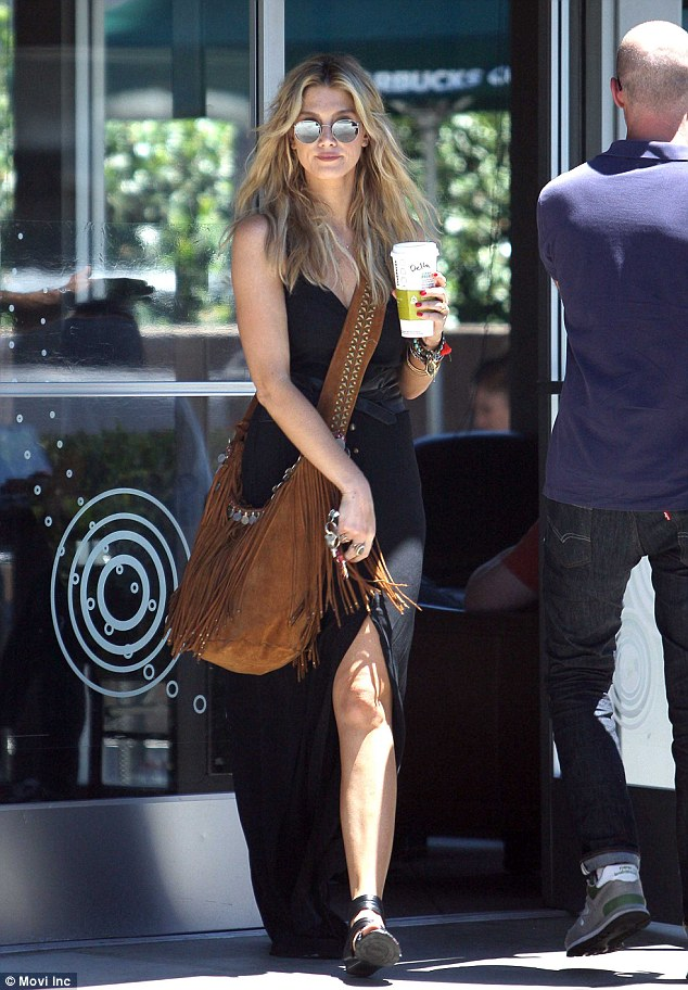 She's got legs! It's been a rough week for Delta Goodrem, who's The Voice winner's song was dumped by music heavyweight Will.i.am, but looking fabulous was her best revenge on Tuesday, when she stepped out for coffee in a thigh-skimming dress