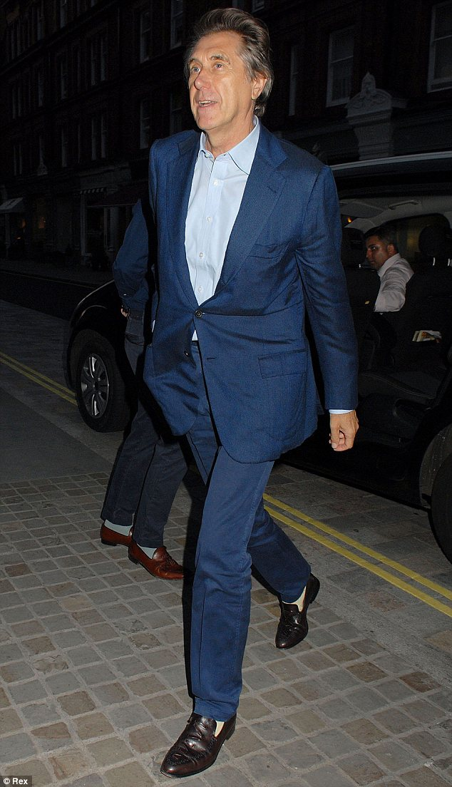 Mr. Smooth: Former Roxy Music singer Bryan Ferry arrived in one of his customary suave suits