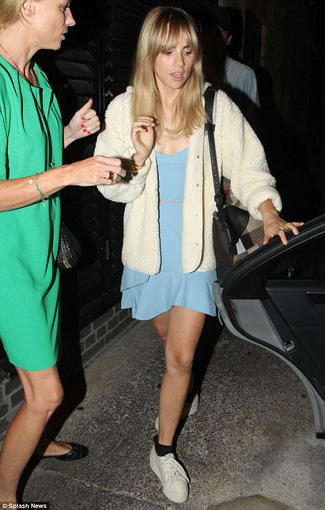 Low key: Suki wore a powder blue dress, fleeced white jacket and chunky Superga trainers with black ankle socks