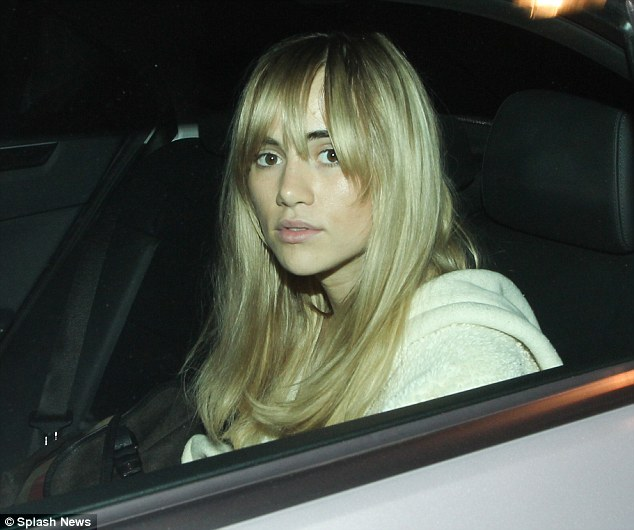 She's off: Suki leaves the Firehouse in the rear of a waiting car
