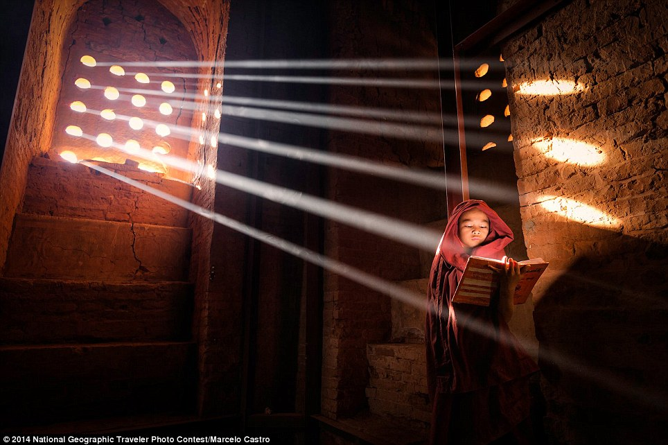 LightSource: Young Monk finds a perfect light source to read his book inside of his pagoda - Old Bagan, Burma (photo and caption by Marcelo Castro)
