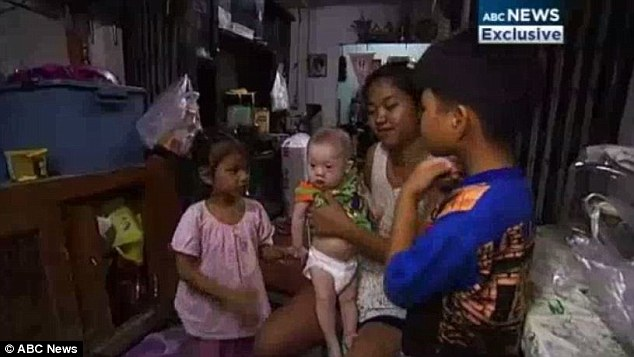 The Thai woman - who lives 90km south of Bangkok - has as three-year-old girl and seven-year-old boy of her own