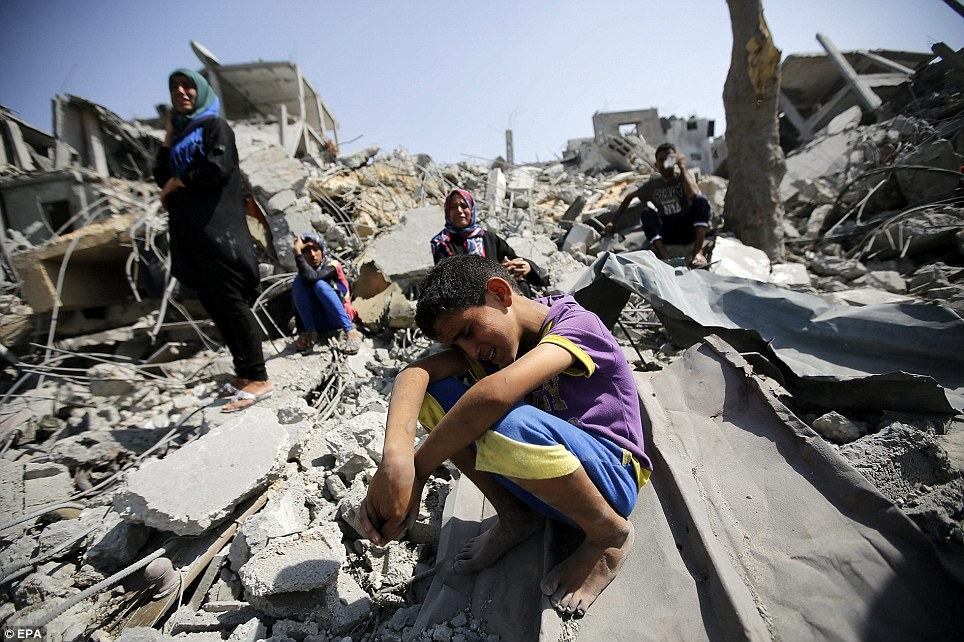 Agony: Seven-year-old Ahmad Al Kafarna cries over the rubble of his destroyed house in Beit Hanun in the northern Gaza Strip as a humanitarian ceasefire broke down
