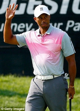 Birdie: Woods acknowledges the crowd at the 16th hole