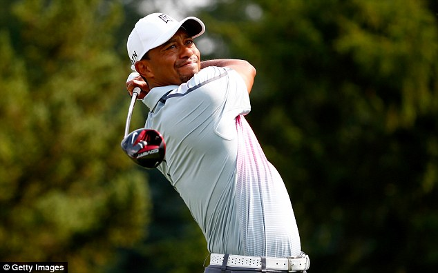Frustrated: but Tiger Woods is making progress as he battles back from injury