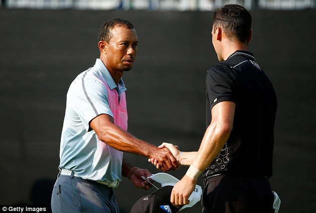 Finishing up: Woods shakes hands with Germany's Martin Kaymer after the first round