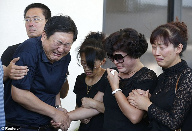 Grief stricken: Parents of murdered USC graduate student Ji Xinran, 24, from China, Du Jinhui (2nd R) and Ji Songbo (2nd L), cry after viewing his body for the first time at a funeral home in Alhambra, California