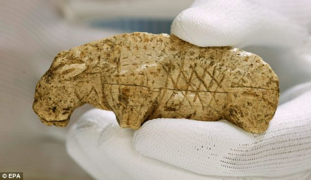 The mane event: 'The figure depicts a lion,' said Professor Nicholas Conard of Tübingen University's Institute of Prehistory and Medieval Archaeology. 'It is one of the most famous Ice Age works of art and until now, we thought it was a relief, unique among these finds dating to the dawn of figurative art'