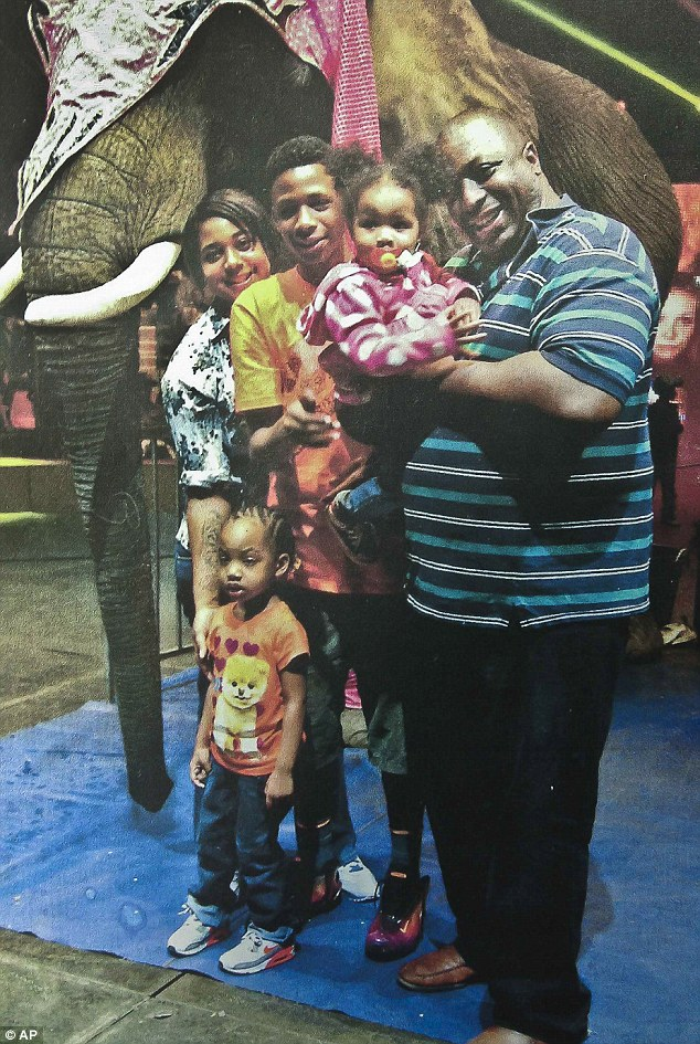 Family man: Eric Garner poses for a picture with four of his five children