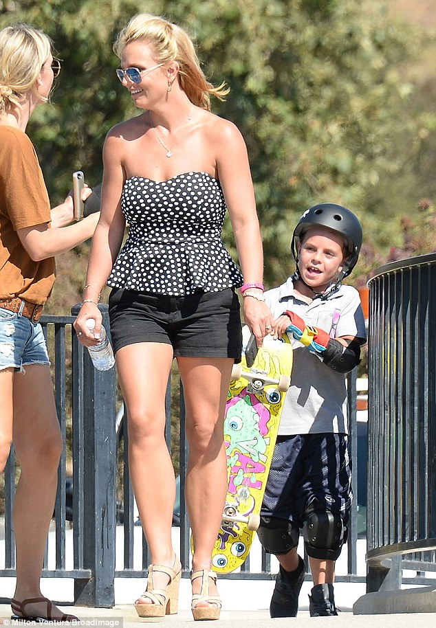 Hot mama: Britney Spears showed off her fine dancer's figure in a polka dotted strapless top and shorts during a trip to the Newbury Park Skateboard Park in Ventura County, California with her sons on Friday