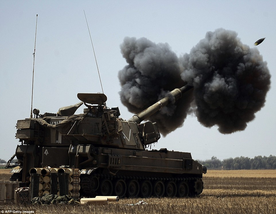 Bombs away: An Israeli artillery fires a 155mm shell towards targets in the Gaza Strip from their position near Israel's border with the Palestinian enclave yesterday