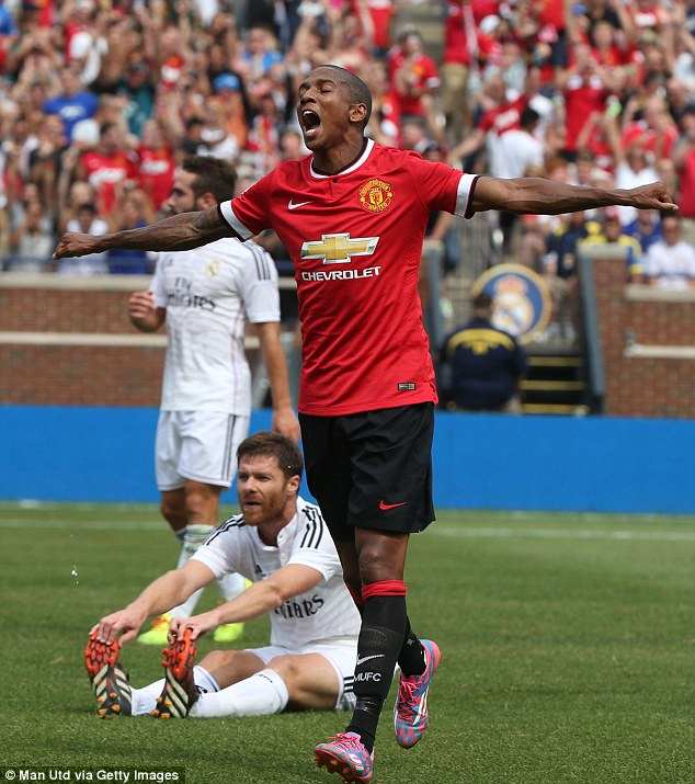 United's hero: Ashley Young struck twice to help his side beat the reigning European champions Real Madrid