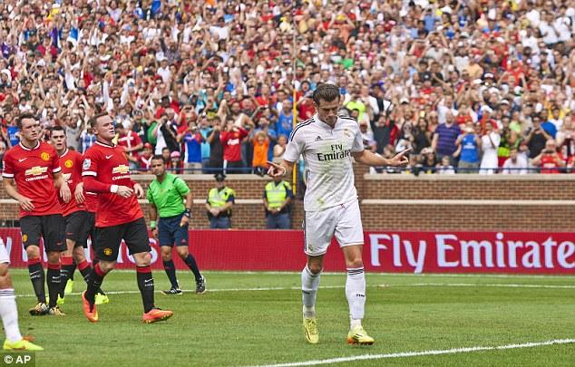 Calm reaction: The Welshman celebrates after firing his penalty past David de Gea