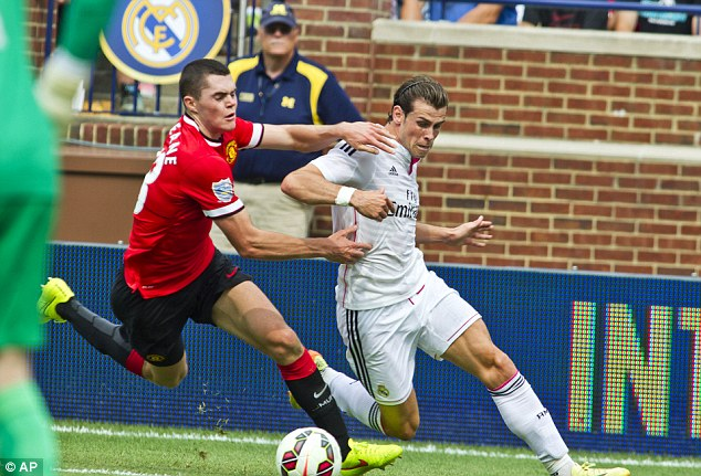 Burst of pace: Gareth Bale draws a foul from Michael Keane inside the penalty area