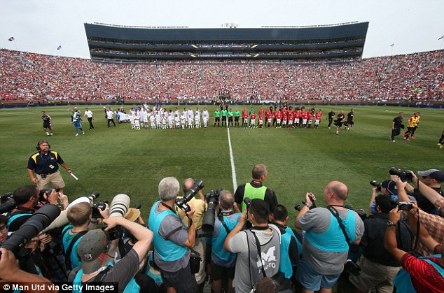 In focus: The two teams line up in front of a capacity crowd at the Michigan Stadium in Detroit