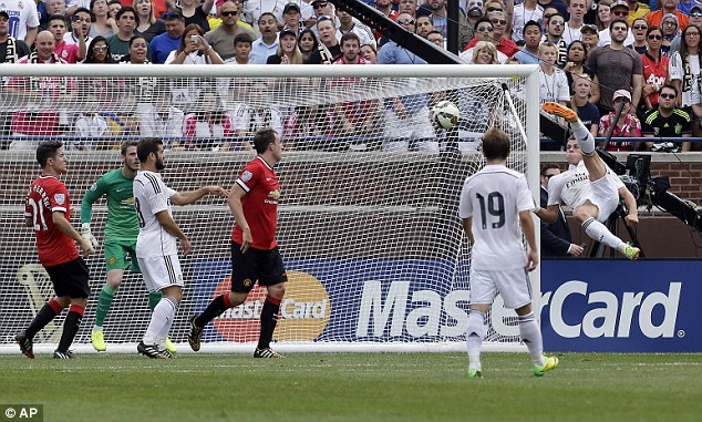 Acrobatic attempt: Gareth Bale forced David de Gea into action with an ambitious overhead kick
