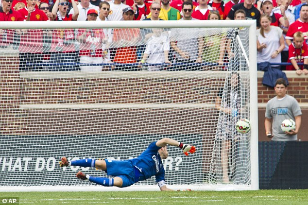 Despairing dive: Casillas did not expect Young's cross to bounce past Rooney when United went 2-1 up
