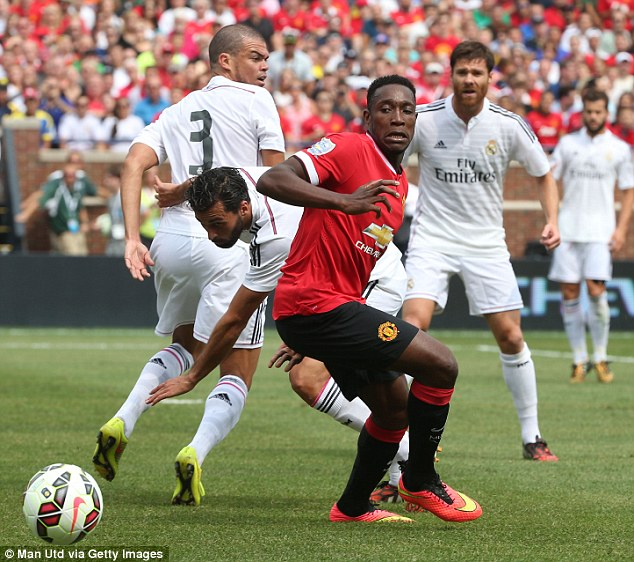 Nice turn: Welbeck spins away from Alvaro Arbeloa for United during the first half in Detroit