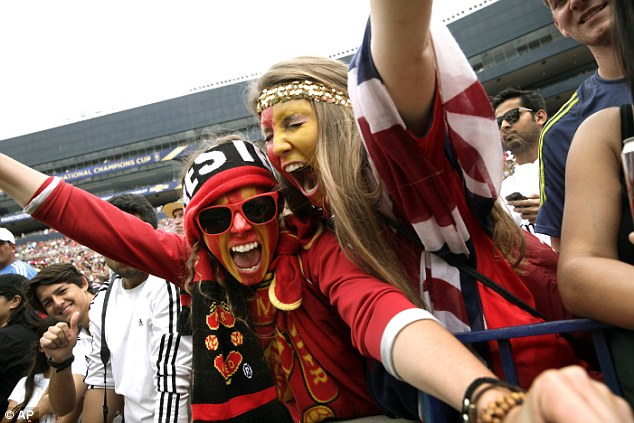 Having a good time: Two United fans cheer on their team during the Guinness International Champions Cup